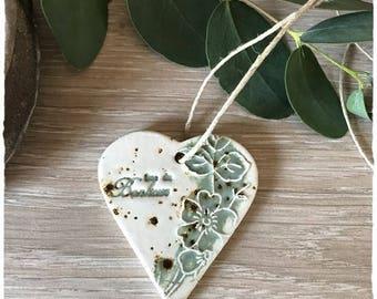 A pretty heart in white, green color ceramic stoneware