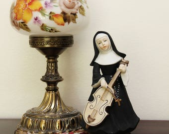 "Vintage 7 1/4"" Tall Ceramic Cello-Playing Musical Nun Figurine - Japan"