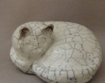 Nestled in raku ceramic cat