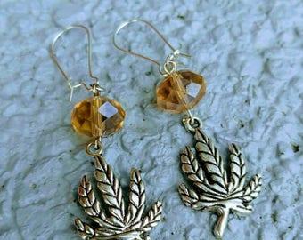 Silver Tone Cannabis Leaf Iridescent Bead Dangle Earrings.