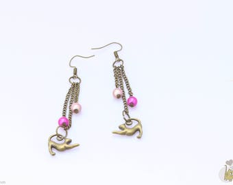 Bronze dangle earrings adorned with pink beads and a cat charm