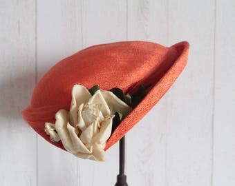 Orange Hat adorned with a cream rose and orange tulle, 30s