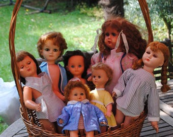 Basket of 7 antique dolls