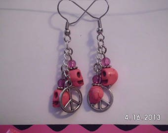 Small pink skulls w/charm earrings.