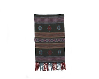 Decorative vintage retro textile artwork: wall hanging handwoven Tapestry with folk pattern. Made in Sweden Scandinavian