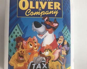 McDonald's Happy Meal Toy VINTAGE - mcdonalds Retro Find -- 1996 Disney Masterpiece Oliver and Company Figure VHS box Figurine