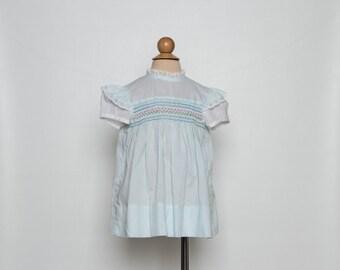 vintage 1970s Polly Flinders girl dress pale blue hand smocked
