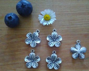 Time to celebrate Spring. 4 beautiful flowers charms, cherry/almond blossoms. Alloy, Antique Silver tone. Finding Jewelry Supply.