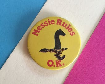 Funny badge - 'Nessie Rules O.K' - Loch ness monster - Scotland, Scottish - Souvenir collectable pinback button - vintage retro 1970s