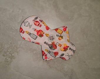 "9"" Light Cloth Menstrual Pad, Asymmetrical Front Bleeder Shape, Cotton Woven Topper, WindPro Fleece Back"