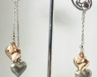 Earring made of silver and freshwater pearls.