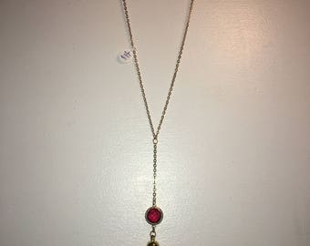 Y necklace with maroon gem and beige faux suede tassel