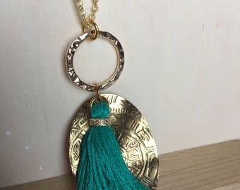 Pendant with leather and brass plate
