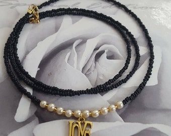 Love pendant and pearl waist beads