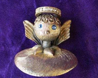 bijoux semi-moderne, broche en métal doré, ange à la couronne en strass blanc et bleu, signée Tortolani,gold metal brooch,angel to the crown