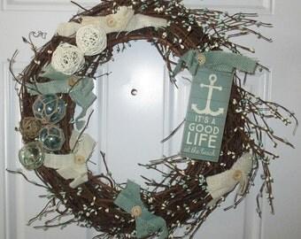 Beach theme large grapevine wreath, burlap-button bows pip berries light teal, cream