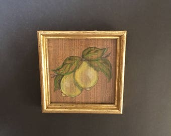 Vintage unsigned small painting of lemons on newspaper
