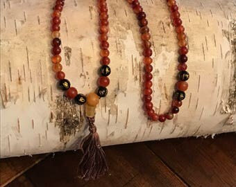 mala with carnelian, glass om beads and cotton