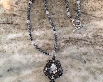 Dark Hematite Beaded Necklace with Accent Pendant