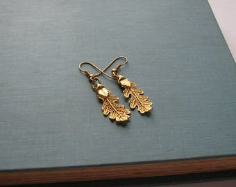 real gold dipped oak leaf earrings . small electroplated leaf earrings on french hooks