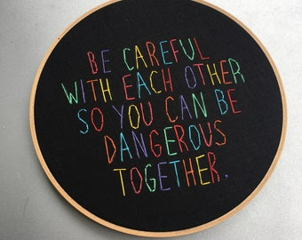 be dangerous - hand drawn and embroidered leftist adage hoop art wall hanging
