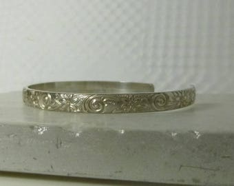 Sterling silver cuff bracelet with patterned wire in flowers and swirls from the Love Collection