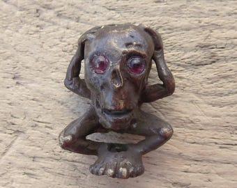 Cast Bronze Bead Homme Outré (Bizarre Man) with Real Garnet Eyes