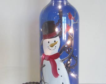 Country Snowman with Cardinals and Birdhouse on a Blue Bottle