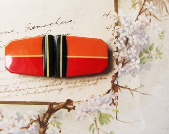 1920s tight top dress buckle - orange and black celluloid and tin - orange and red two part buckle - vintage sewing notions