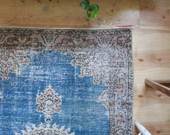 vintage Turkish rug, rustic faded turquoise floral rug, happy worn bohemian rug