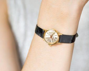 Small women's wristwatch TISSOT Seastar 7, gold plated lady watch water resistant, sporty Swiss women watch, luxury or premium leather strap