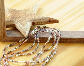 gorgeous necklace with small glass beads and metal beads