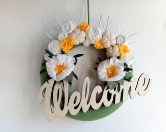 Welcome wreath with fabric flowers, branches and WELCOME wooded writing