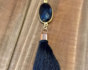 Gold Faceted Onyx like gem with drop tassle