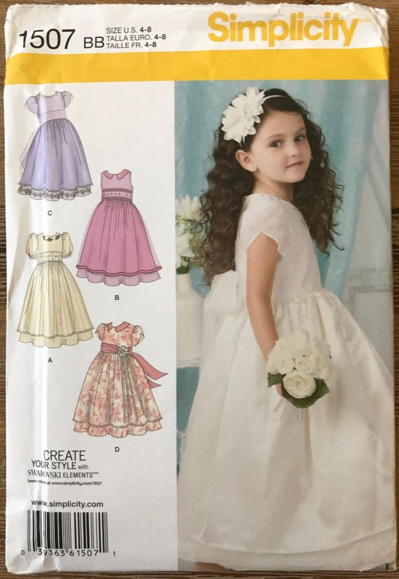 Uncut Child S Dress Sewing Pattern Simplicity 1507 Holiday