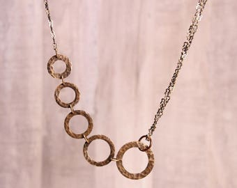 "Hammered copper asymmetrical ""Rings"" graduated necklace"