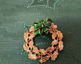 Holiday festive Christmas wreath in gold tone metal with green and red enamel