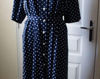 Navy blue dot vintage dress with matching belt. 1940s style