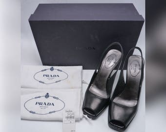 PRADA Black Leather Peep Toe Pumps / Heels comes W/ original box, dustbags & tag