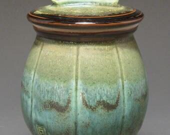 Lidded jar with manzanita twig handle, patina green and temmoku glazes