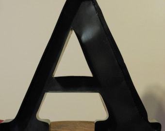 A Large, Black Metal Letter A