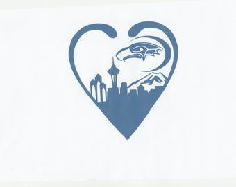 Seattle skyline in heart with seahawk moon