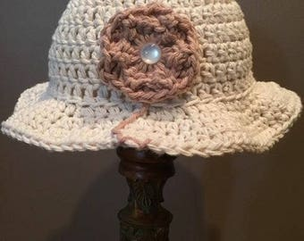 Hand knit Baby sun hat with and flower
