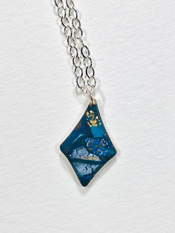 Handmade blue/white/gold/silver polymer clay necklace with abstract asymmetric design and silver plated chain