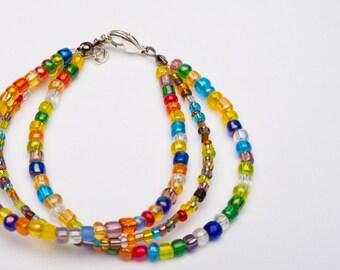 Rainbow Three Strand Glass Bead Bracelet