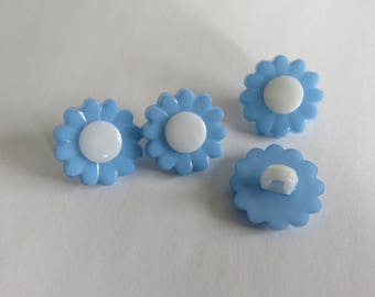 White and blue flower shaped button