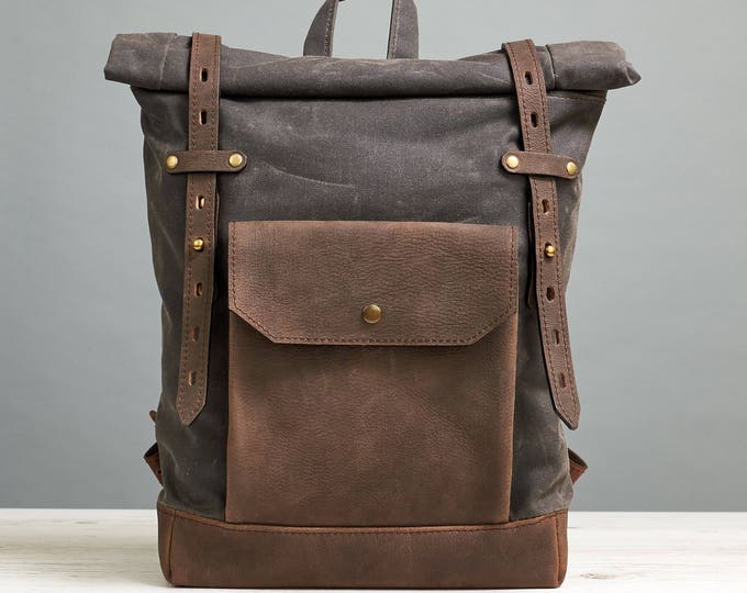 Small laptop backpack. Dark chocolate waxed canvas. Dark brown leather.