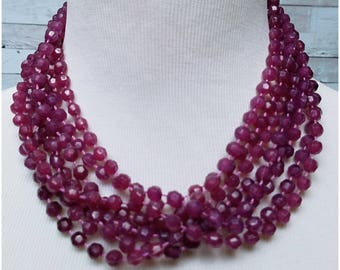 Faceted plastic rosy purple multi stranded beaded silver tone necklace
