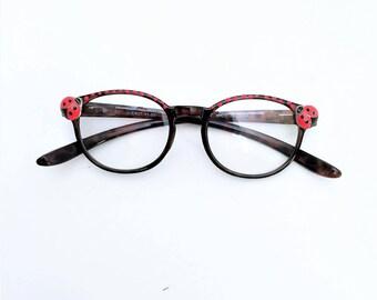 Reading glasses with ladybug +1.00