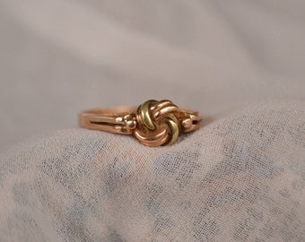 Unique and eye-catching simple vintage 14K two-tone rose gold knot ring